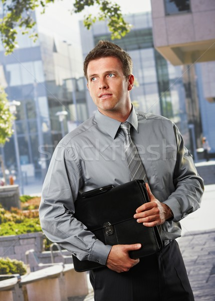 Businessman with briefcase outside office Stock photo © nyul