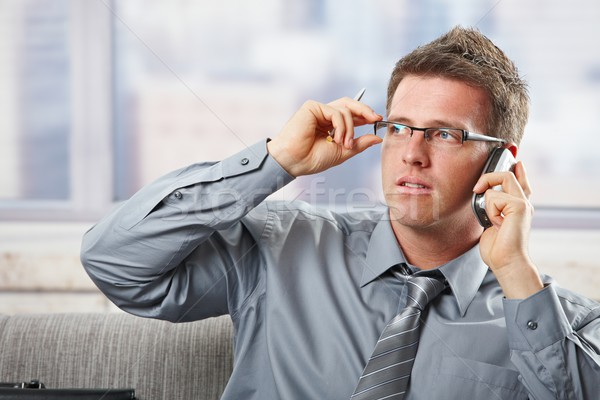 Businessman with glasses on phonecall Stock photo © nyul