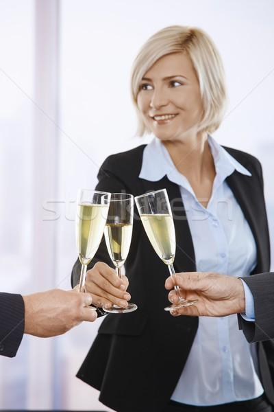 Stockfoto: Zakenlieden · vieren · champagne · succes · toast · focus