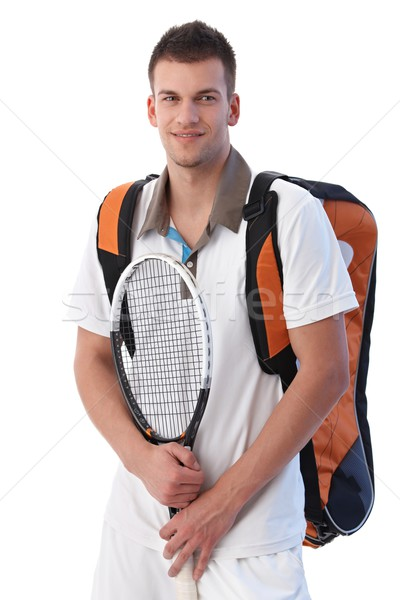 Stock photo: Young tennis player with equipments smiling