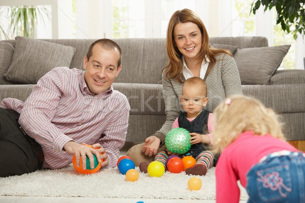 Family playing with balls Stock photo © nyul