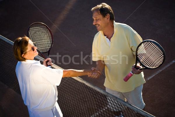Aktív idős tenisz partnerek idős pár kézfogás Stock fotó © nyul