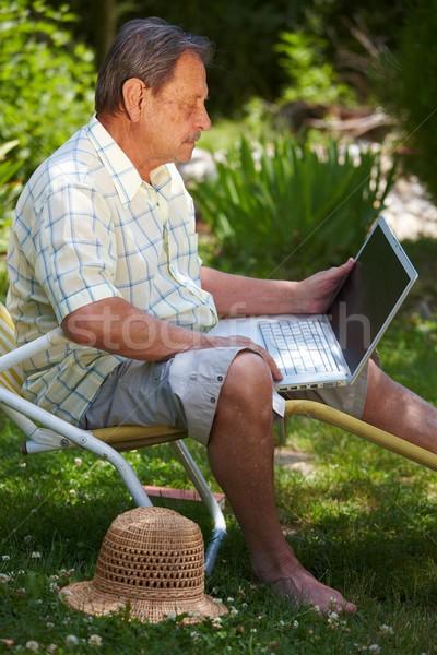 Senior man using laptop outdoor Stock photo © nyul