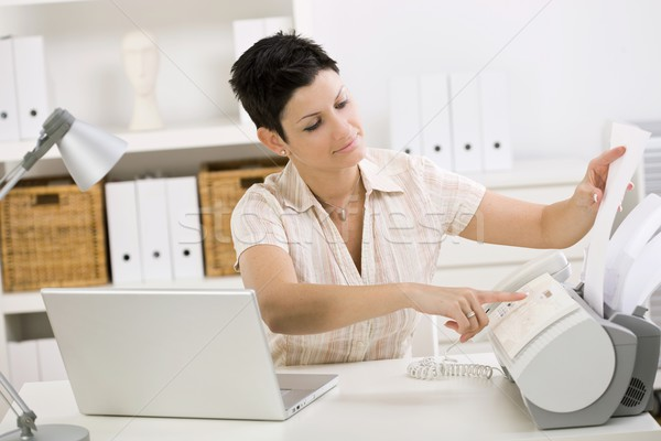 Woman using fax machine Stock photo © nyul