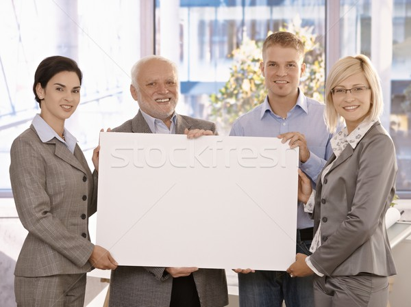 Businessteam holding blank poster for copy space Stock photo © nyul