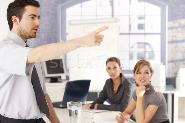 Stock photo: Young office worker leading business training