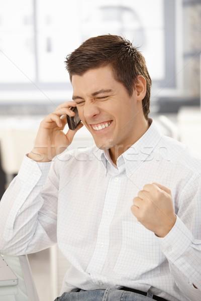 Felice imprenditore una buona notizia telefono cellulare business Foto d'archivio © nyul