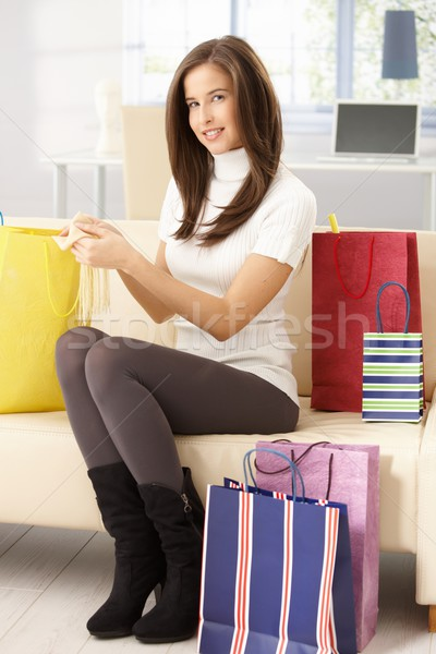 Happy woman after shopping at home Stock photo © nyul