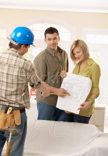 Couple in discussion with builder Stock photo © nyul