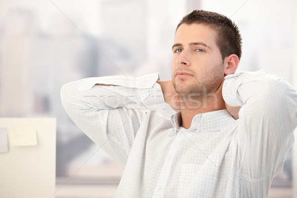 Young man thinking in office Stock photo © nyul