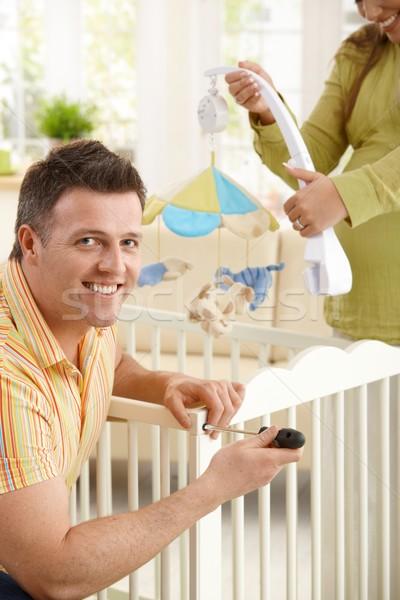 Retrato hombre cuna sonriendo cámara Foto stock © nyul