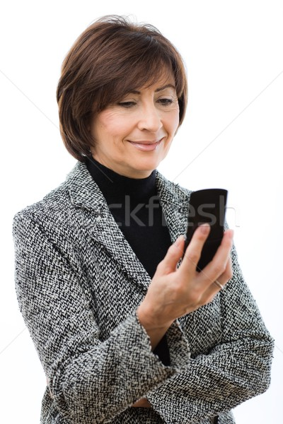 Senior businesswoman using mobile phone Stock photo © nyul