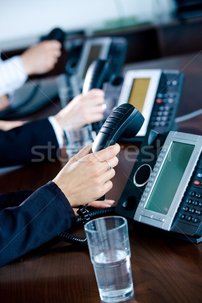 Hands holding phones Stock photo © nyul
