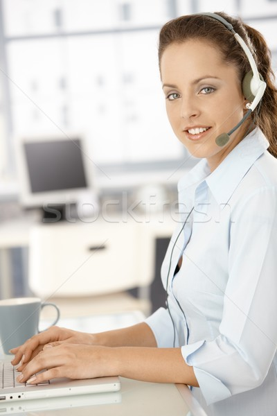Pretty dispatcher working in bright office smiling Stock photo © nyul