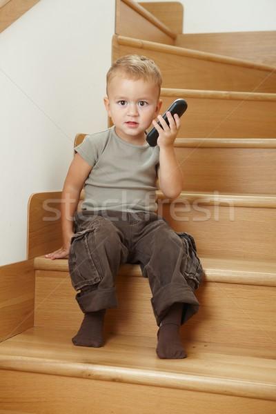 мало мальчика сидят лестницы играет портативный Сток-фото © nyul