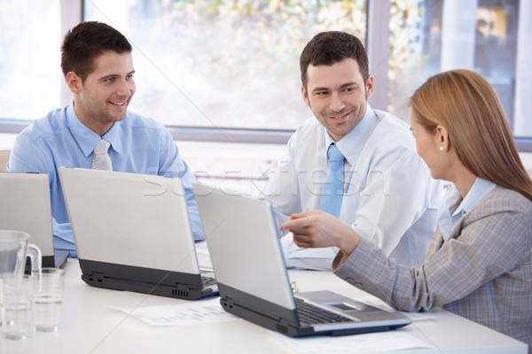 Happy team of businesspeople working together Stock photo © nyul