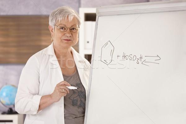 Senior teacher teaching chemistry Stock photo © nyul