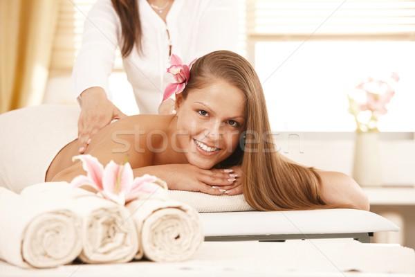 Happy young woman enjoying back massage Stock photo © nyul