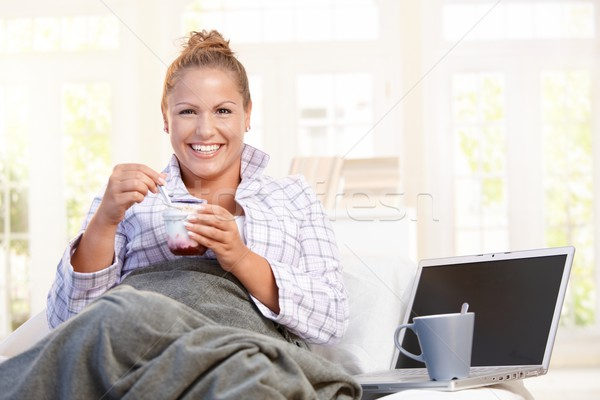 Young female having low fat breakfast in bed Stock photo © nyul