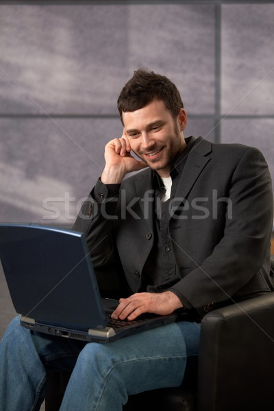 Mid-adult office worker with laptop Stock photo © nyul
