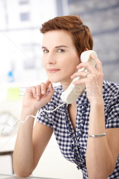 Young woman on landline call Stock photo © nyul