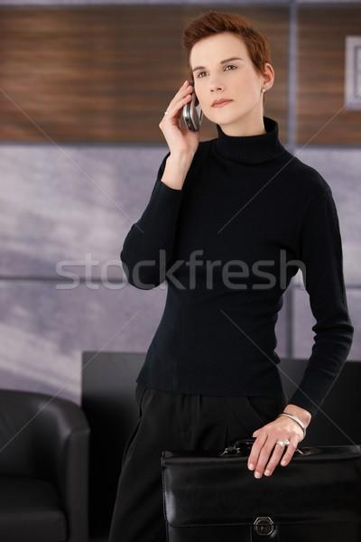 Elegant businesswoman in office Stock photo © nyul