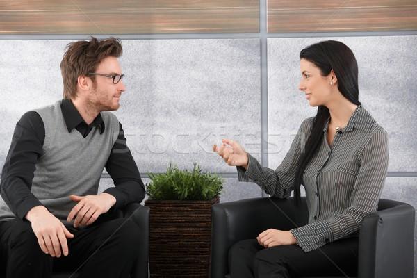 Fiatal kollégák beszél iroda ül lobbi Stock fotó © nyul