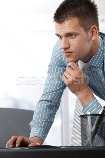 Casual office worker using computer Stock photo © nyul