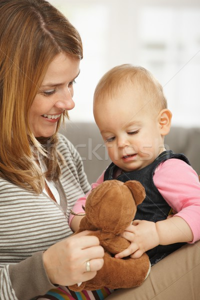Happy mum and baby with teddy bear Stock photo © nyul