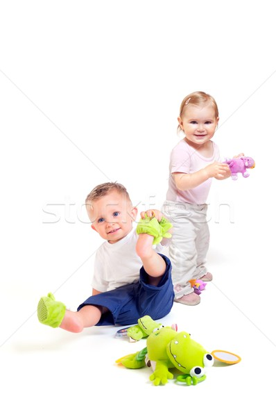 Stock photo: Babies play with toys