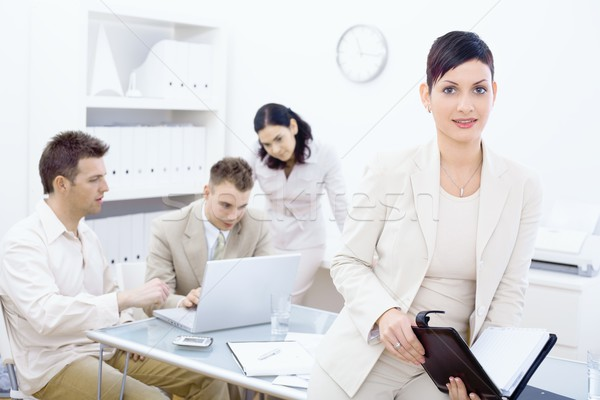 Businesswoman holding organizer Stock photo © nyul