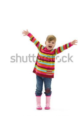 Heureux petite fille coloré chandail jeans rose Photo stock © nyul
