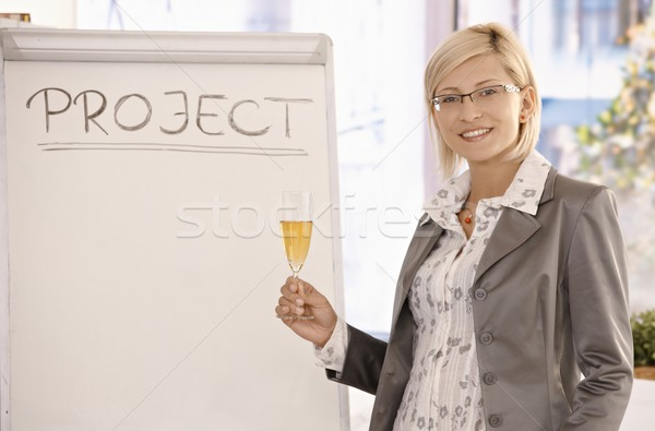 Smiling businesswoman with champagne Stock photo © nyul
