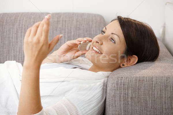 Happy woman talking on mobile Stock photo © nyul