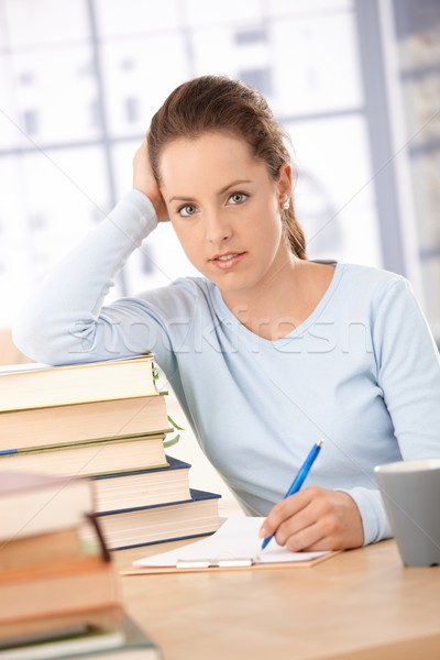 Happy student learning at home smiling Stock photo © nyul