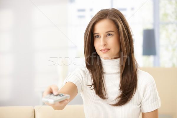Attractive woman with remote control Stock photo © nyul