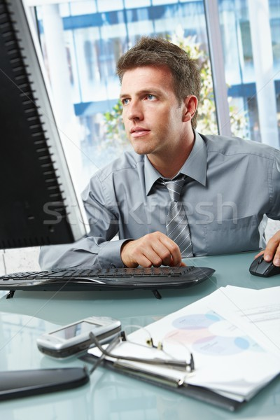 Businessman concentrating on work in office Stock photo © nyul