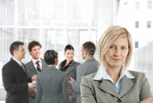 улыбаясь деловая женщина служба лобби коллеги говорить Сток-фото © nyul