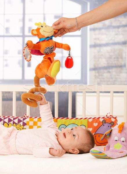 Stock photo: Happy baby girl playing