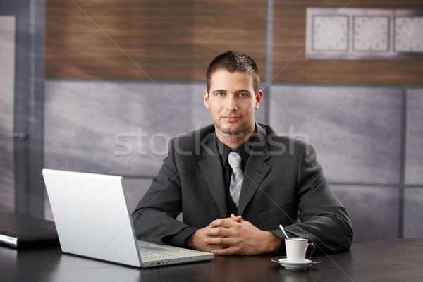 Confident manager sitting in fancy office smiling Stock photo © nyul