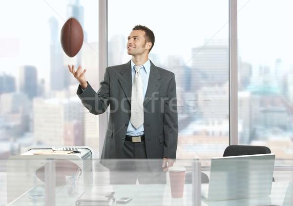 Businessman playing with football Stock photo © nyul