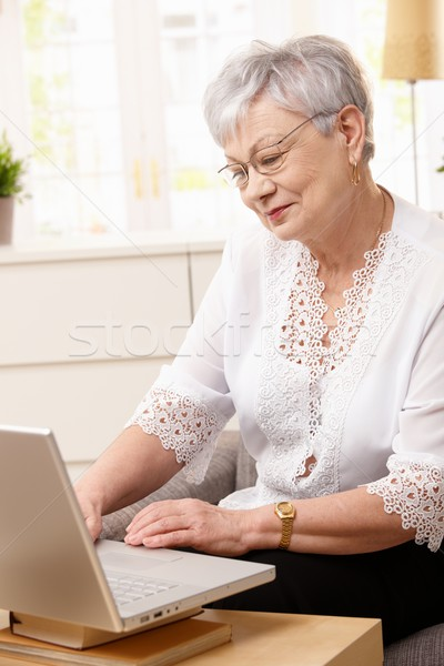 Senior woman browsing internet Stock photo © nyul