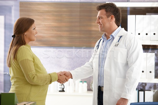 Doctor congratulating to pregnant woman Stock photo © nyul