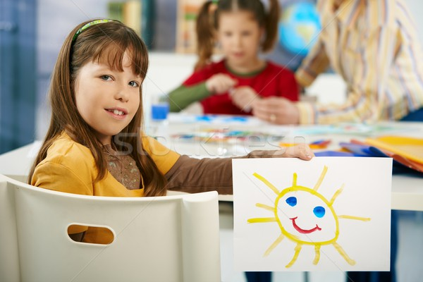 Elementary age girl with painting at school Stock photo © nyul