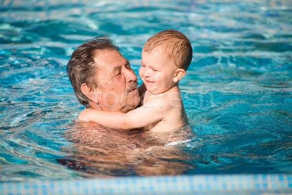 Grandfather swimming with grandson Stock photo © nyul