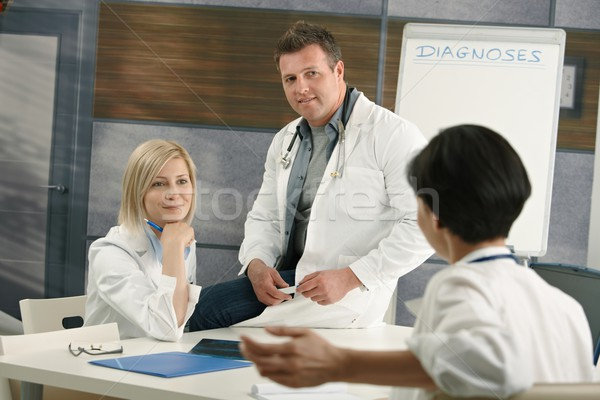 Medical doctors discussing diagnosis Stock photo © nyul