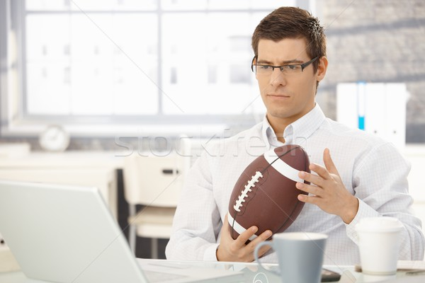 Troubled businessman thinking holding football Stock photo © nyul