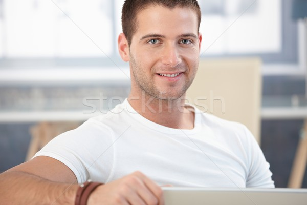 Portrait of handsome man smiling Stock photo © nyul