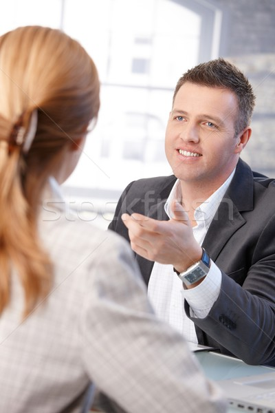 Male manager interviewing female candidate smiling Stock photo © nyul