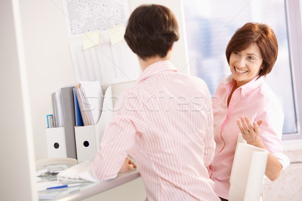 Cheerful office workers at desk Stock photo © nyul